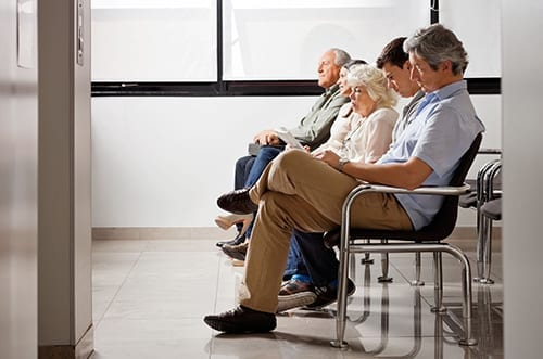 Group of people sitting in waiting area